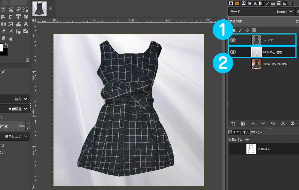 読み込んだ背景画像は、洋服のレイヤーの下に配置